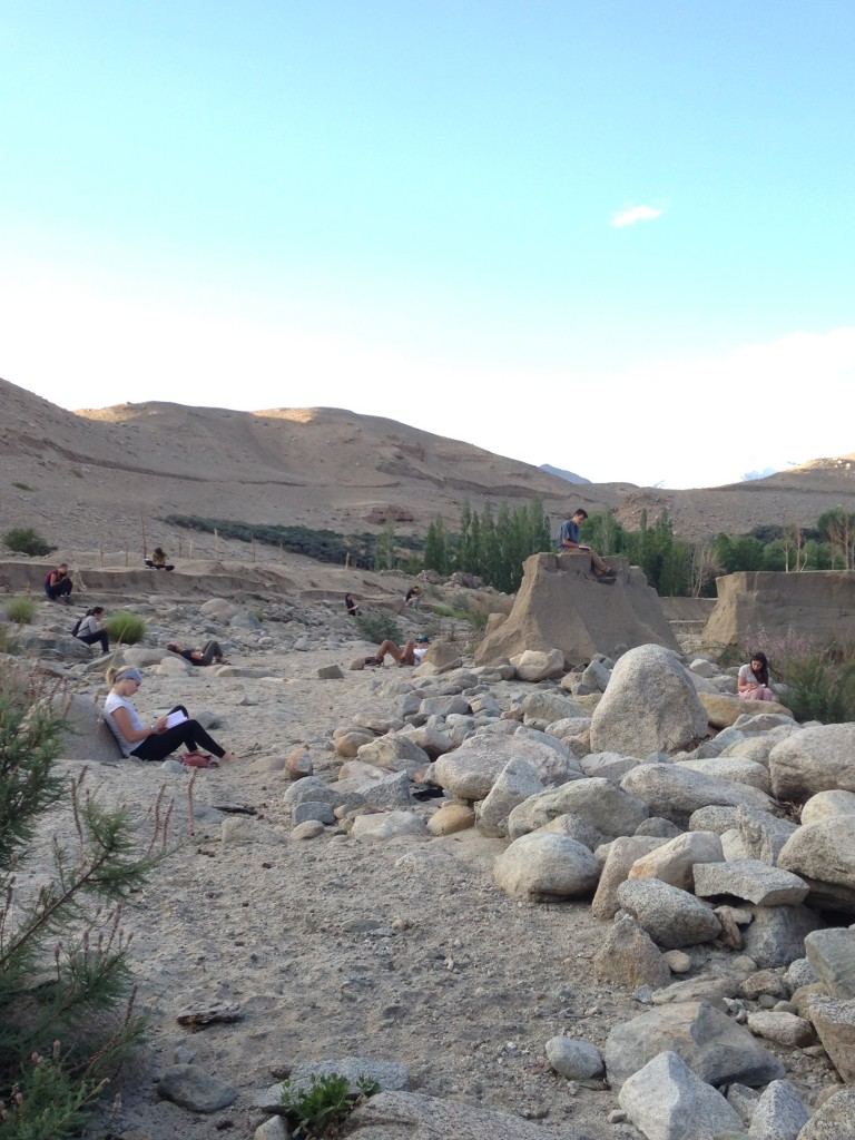 The group journaling on the banks of the Indus River